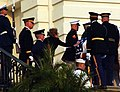 US Navy 040609-A-5968S-064 Former First Lady Nancy Reagan touches the flag-draped casket of former President Ronald Reagan on the steps of the U.S. Capitol.jpg