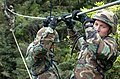 US Navy 050221-N-9712C-003 Seabees assigned to Naval Mobile Construction Battalion Four Zero (NMCB-40), cross a two strand bridge over a thirty foot drop at the Jungle Warfare Training Center in Okinawa, Japan.jpg