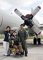 US Navy 050325-N-3122S-010 Yuma Tanaka, center, his mother and Lt.j.g. Matt Delgado pose for a photo after completing a tour of a P-3C Orion during a flight-line tour at Kadena Air Base.jpg