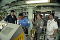 US Navy 060605-N-4491L-007 Quartermaster 1st Class Brandt Thionnet assigned to the mine warfare ship USS Patriot (MCM 7), discusses the intricacies of the bridge with Navy personnel from Malaysia and Australia.jpg