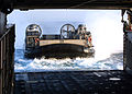 US Navy 070209-N-6710M-001 A Landing Craft Air Cushion (LCAC) prepares to enter the well deck of dock landing ship USS Tortuga (LSD 46) after an offload of Marine equipment in the vicinity of Okinawa, Japan.jpg