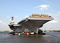 US Navy 070425-N-8403A-107 Tug boats steady the bow of USS George Washington (CVN 73) as the aircraft carrier transits from dry dock to a wet slip.jpg
