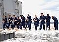 US Navy 070528-N-4918C-004 Sailors from USS Blue Ridge (LCC 19) Deck department scrub the flight deck following a counter measure wash down and aqueous film forming foam (AFFF) sprinkling system test.jpg