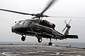 US Navy 070625-N-5067K-015 An SH-60F Seahawk, attached to the Warlords of Helicopter Antisubmarine Squadron Light (HSL) 51, lands aboard amphibious transport dock USS Juneau (LPD 10) for refueling while carrying Australian Army.jpg