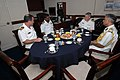 US Navy 070702-N-7647G-009 Rear Adm. Terry Blake, center right, and Capt. Michael Manazir, left, visit with Commodore Rajendra Singh, center left, and Inspector General P.E. Vanhaltren, right, of the Indian coast guard on board.jpg