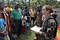 US Navy 070808-N-9421C-134 Lt. Lydia Battey discusses the symptoms of tuberculosis to local residents at Bunabun Health Center.jpg