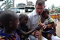 US Navy 070908-N-3255B-007 Musician 3rd Class Jeremy Saunders, of the U.S. Navy Europe-Africa rock band, Topside, entertains children at Yatima Group Orphanage.jpg