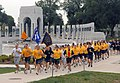 US Navy 070914-N-1281L-016 National Capital Region chief petty officers and chief selectees pass the National World War II Memorial during a pride run.jpg