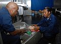 US Navy 080913-N-2733C-020 Hospital Corpsman 2nd Class Antoinette Peterson and Hospital Corpsman 2nd Class Darrius Torrence inventory medical and emergency supplies aboard the amphibious assault ship USS Nassau (LHA 4).jpg