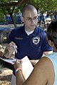 US Navy 090627-F-7923S-062 Nicholas Berry administers medications from the pharmacy at Centro Escular Ramon Mendoza school during a Continuing Promise 2009 medical community service project.jpg