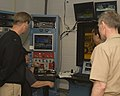 US Navy 091013-N-4288H-006 Engineering Technician Wayne Wood, second from the left, explains instrument readings from a biofuels test on an F404 engine from an F-A-18.jpg