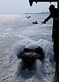 US Navy 100203-N-5538K-055 An amphibious assault vehicle from the 31st Marine Expeditionary Unit (31st MEU) exits the well deck of the forward-deployed amphibious transport dock ship USS Denver (LPD 9).jpg