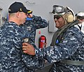 US Navy 100519-N-8446A-003 Capt. O.P. Honors Jr., left, commanding officer of the aircraft carrier USS Enterprise (CVN 65), welcomes Vice Adm. Mel Williams Jr., commander of U.S. 2nd Fleet, aboard the ship.jpg