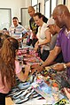 US Navy 100720-N-1938G-008 Sailors assigned to the guided-missile destroyer USS Ramage (DDG 61) help children pick out a toy at the Toto Liardo Youth Center during a community service event. T.jpg