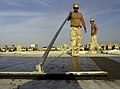 US Navy 100925-N-6436W-106 Seabees assigned to Naval Mobile Construction Battalion (NMCB) 40 place concrete for a project at Camp Deh Dadi II, Afg.jpg