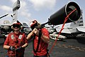 US Navy 110225-N-8040H-236 Sailors prepare to shoot a phone and distance line during a replenishment at sea.jpg