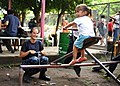US Navy 110803-N-NY820-383 Hospital Corpsman 3rd Class Jennifer Nuehring, from Elgin, Ill., plays with a child at the Escuela Fray Casiano de Madri.jpg