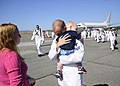 US Navy 110909-N-ZK021-002 Logistics Specialist 2nd Class James McDowell hugs his son during a homecoming ceremony at Naval Air Station Whidbey Isl.jpg