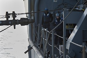 US Navy 120129-N-KS651-403 Sailors from the deck department of the amphibious dock landing ship USS Pearl Harbor (LSD 52) watch a fuel probe being.jpg