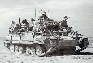 British Army during the Second World War - Valentine tank in the desert, carrying an infantry section.
