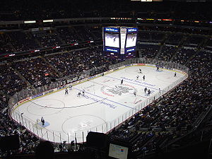 An interior view of the Verizon Center showing the ice, the stands, and the overhead video monitor