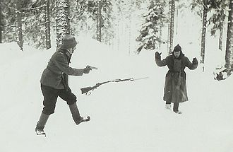 Soviet prisoners of war in Finland - Soviet soldier surrenders to a Finnish soldier during the Continuation War. The photo may have been staged.