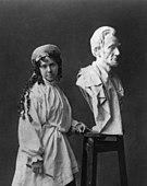 Vinnie Ream with her earlier bust of Abraham Lincoln