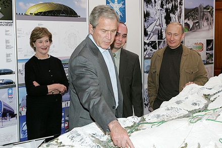 Vladimir Putin with George W. Bush and Laura Bush examining the models of the Olympic facilities for Sochi, April 2008