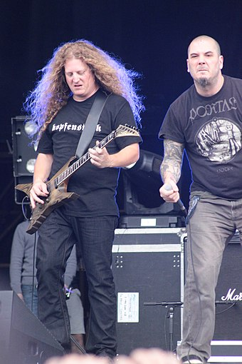 Anselmo (right) performs with The Illegals in 2013 W0939-Hellfest2013 Voivod DanielMongrain PhilAnselmo 70930.JPG