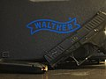 Walther PPQ + magazine in front of case.jpg