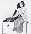 Woman with Batik in Ad 2 Dunia Film 1 May 1955 p29.jpg
