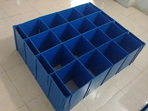 Corrugated plastic -   Corrugated plastic dividers used to pack automotive components.
