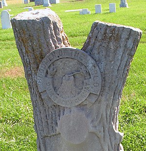 WoodmenLife - Cemetery stone with Woodmen logo.