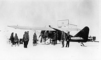 Wop May loads his airplane at Aklavik