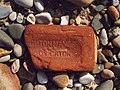 Worn Brick on Beach near Heysham atomic powerstation.jpg