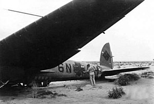 Wrecked He 111H KG 100 at Fuka 1942.jpg