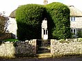 Yew hedge arch at Chardstock, Devon.jpg