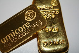 Gold bar - A minted bar (left) and a cast bar (right)