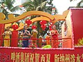 云南省西双版纳傣族自治州景洪市2009年传统泼水节日里包含铜臭照片-啤酒广告希望车上的不要喝 - panoramio.jpg