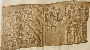 Free Dacians - Left panel: Rural Dacian families are forced to leave their homes, taking their livestock (sheep, cattle and goats) with them, as the last garrisons of Dacian forts, including the one in the background, surrender to the Romans (shown on previous panel). Right panel: Roman emperor Trajan (r. 98-117) (on podium, centre) congratulates his victorious troops. Detail from Trajan's Column, Rome