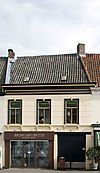 foto van Verbouwd huis met ouder zadeldak