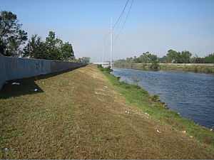 17th Street Canal - A portion of the 17th Street Canal, looking lakeward from behind the Metairie Road Pumping Station. Note the levees topped with concrete flood walls.