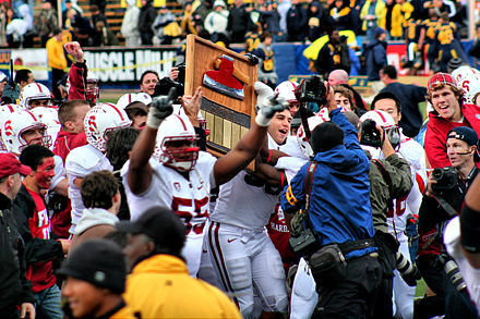 Stanford players lift the Stanford Axe after winning the 2010 Big Game 2010 Big Game.jpg