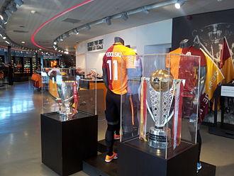 Lukas Podolski - Podolski's Galatasaray shirt, on display with the Süper Lig and Turkish Cup