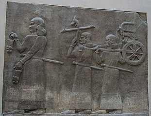 Servants carrying a wheeled throne-AO 19882