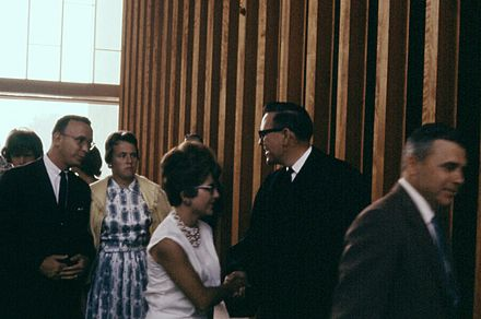 Schuller greeting parishioners after a Sunday service at the Garden Grove Community Drive-In Church, July 1962 6207-RevRobtSchullerGrdnGrvChurch.jpg