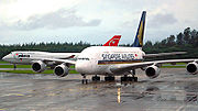 A Singapore Airlines Airbus A380 and a Northwest Airlines Boeing 747 at Changi Airport.