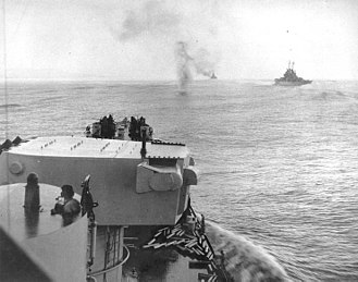Battle of Empress Augusta Bay - A Japanese aircraft crashes (upper center) into the ocean near the US cruiser Columbia on 2 November 1943, during air attacks on Allied ships off Bougainville, a few hours after the Naval Battle of Empress Augusta Bay.