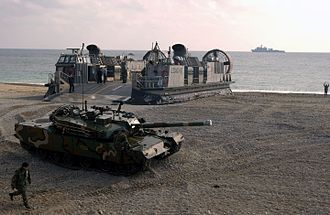 Foal Eagle - An ROK Army K1 tank disembarks from a U.S. Navy Landing Craft Air Cushion during RSOI/Foal Eagle 2004