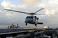 A U.S. Navy MH-60S Seahawk helicopter attached to Helicopter Sea Combat Squadron (HSC) 12 takes off from the aircraft carrier USS George Washington (CVN 73) with fresh water and support personnel during 131116-N-XN177-039.jpg